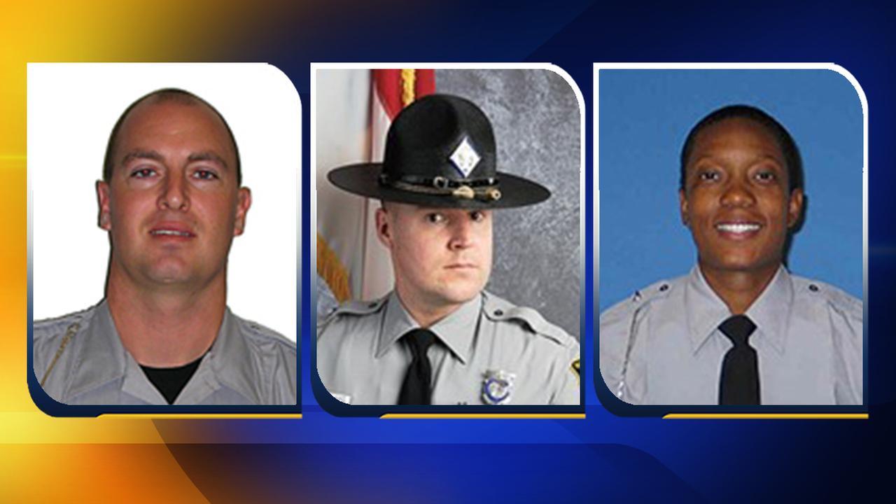 From left, Wake County Master Deputy Cameron Broadwell, State Trooper Michael G. Blake and State Trooper Tabitha L. Davis.