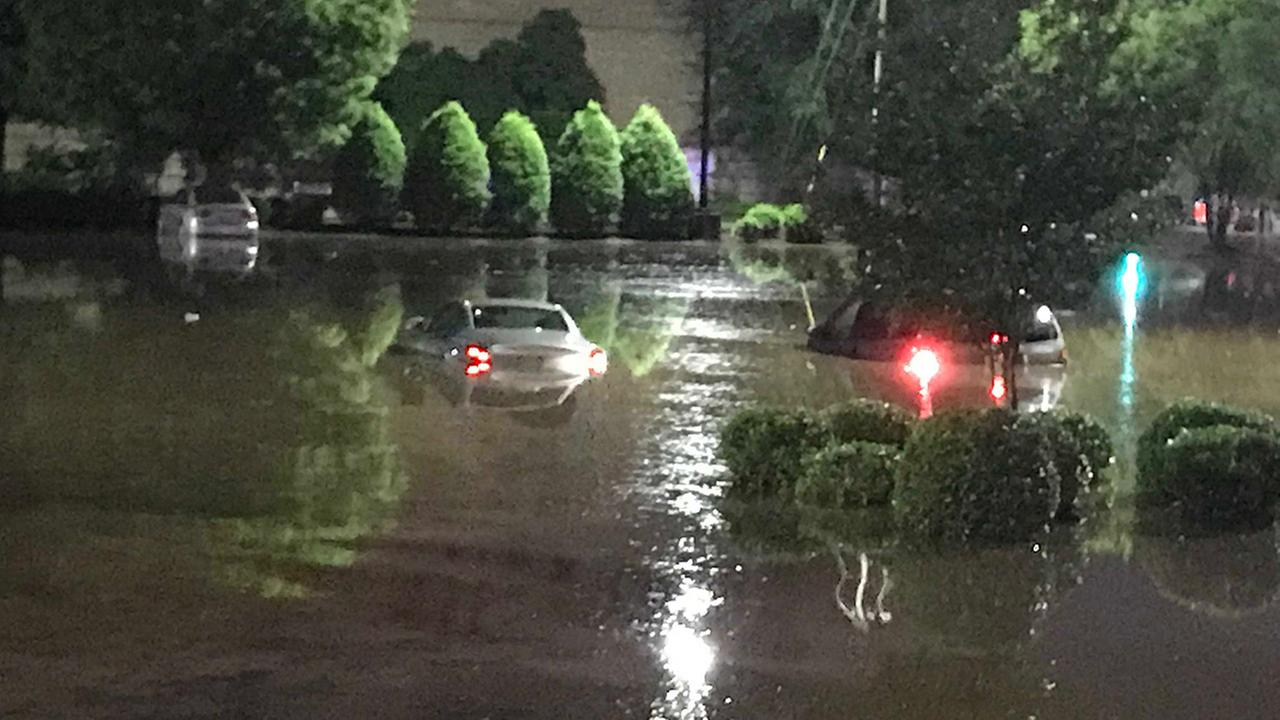 Cars are submerged Monday in the Crabtree mall parking lot.