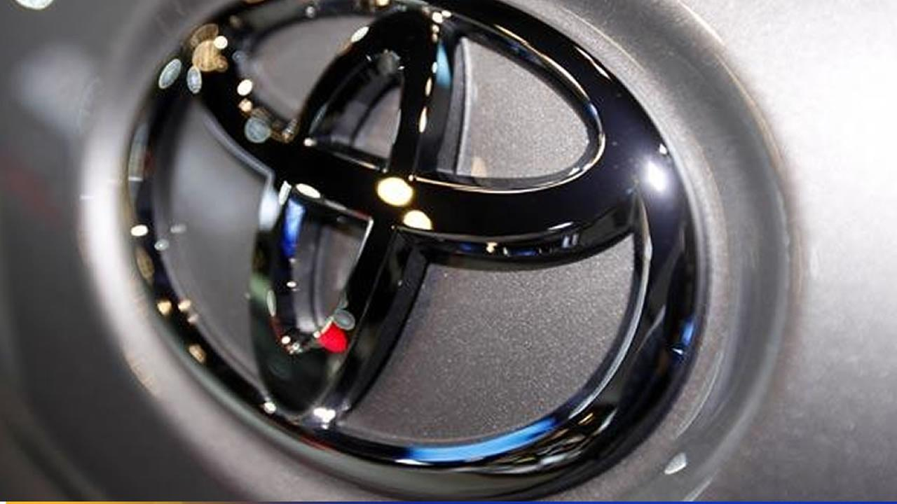 In this March 31, 2010 file photo, the Toyota logo is seen on a car displayed at the New York International Auto Show in New York.