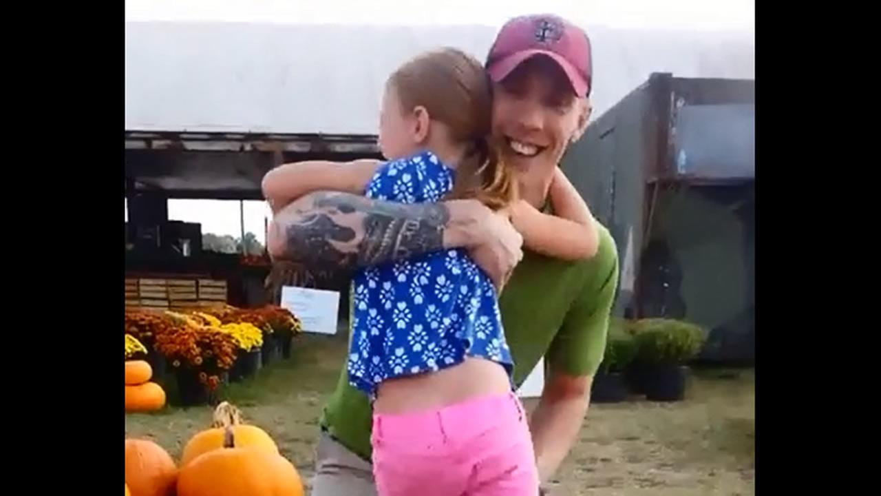 Levi Kaplan surprised his daughter at a pumpkin patch. (image courtesy Meg Kaplan/YouTube)