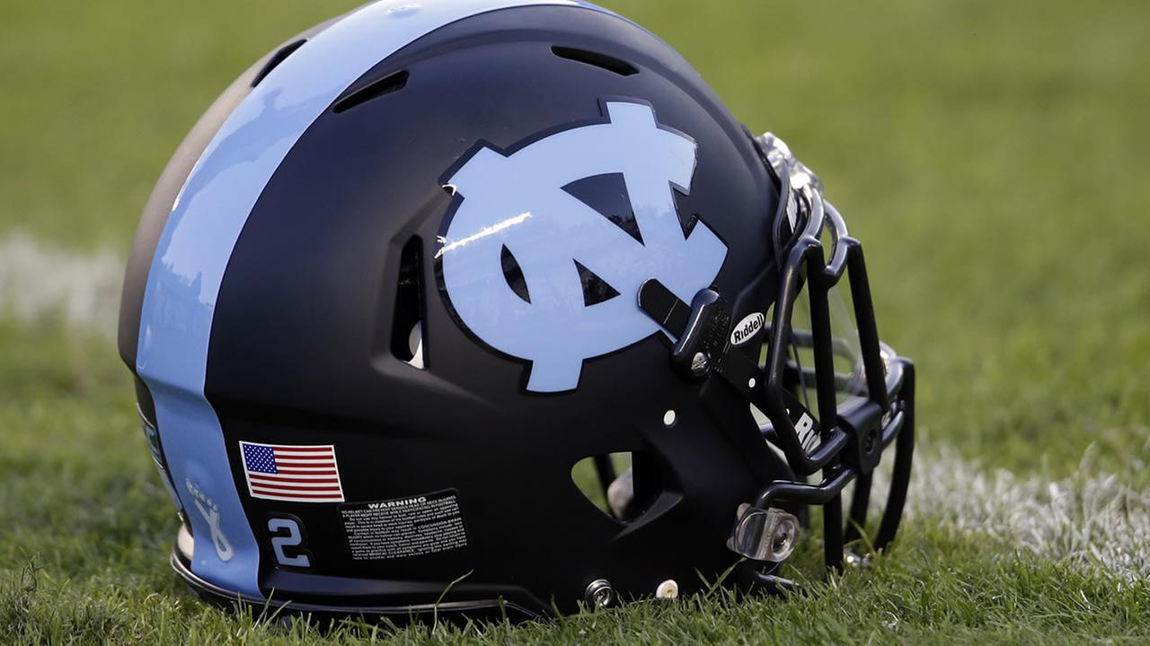A North Carolina helmet is shown on the field prior to an NCAA college football game. (AP Photo/Gerry Broome)