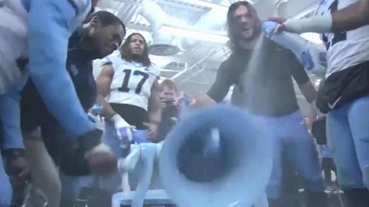 UNC players spray paint the bell after the victory.