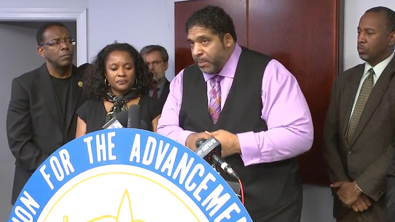 NAACP leader Rev. Dr. William Barber speaks to reporters.
