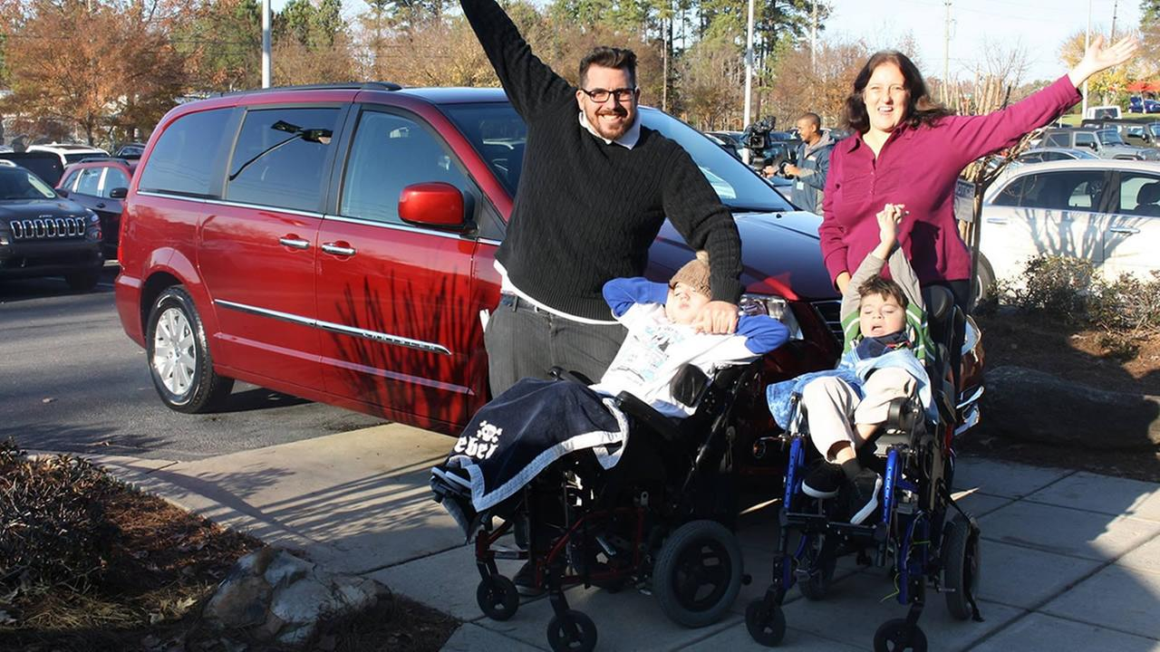 The Mills family celebrates their new van.