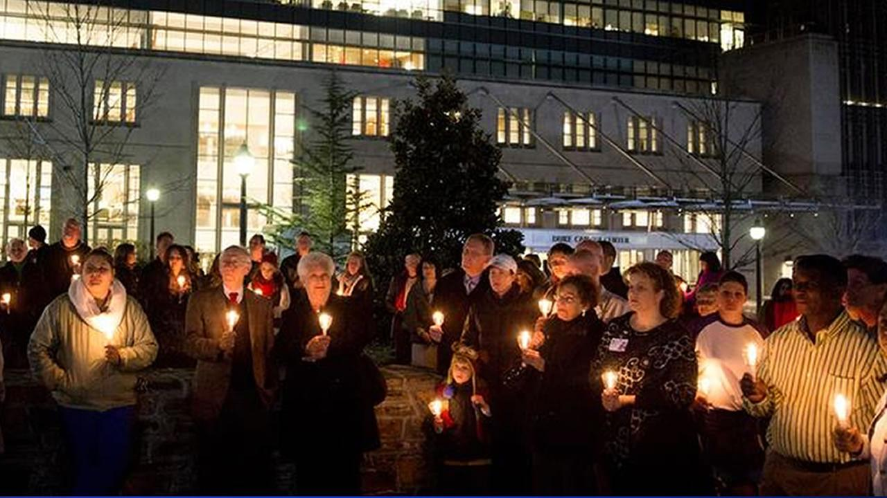 The grounds of the Duke Cancer Institute glowed Thursday night with 200 candles and 3,000 tiny lights for the 24th Tree of Hope ceremony.