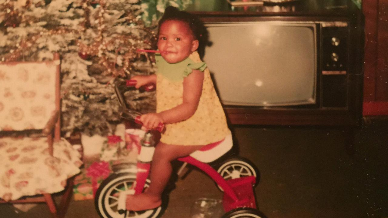 Tisha Powell riding a tricycle she got for Christmas one year.WTVD