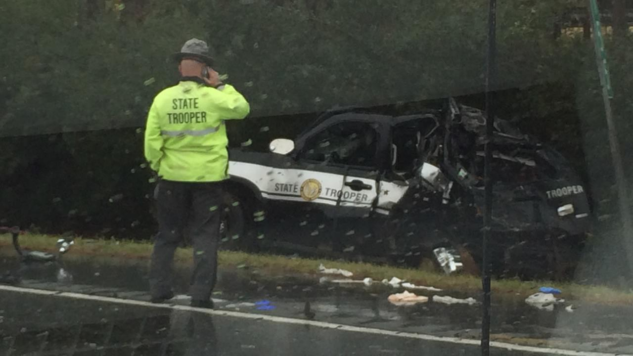 The back of the NC Highway Patrol SUV was crushed by a collision with a Greyhound bus (image courtesy WGHP-TV)