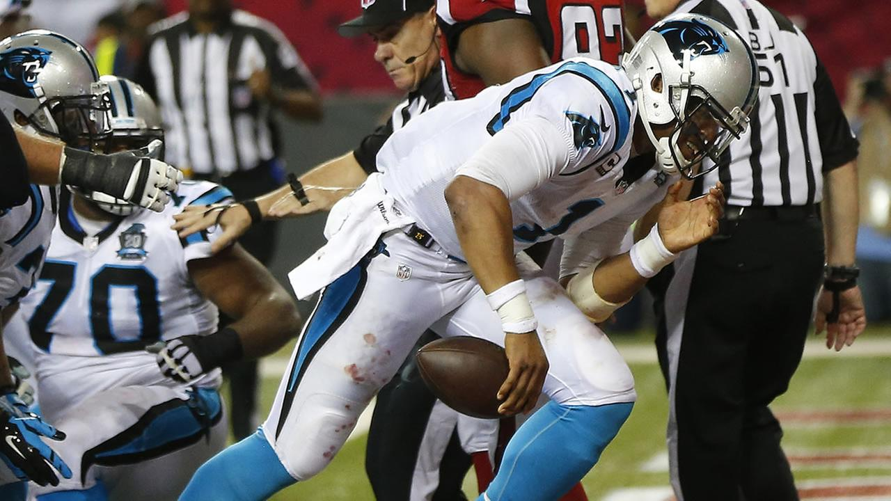 Carolina Panthers quarterback Cam Newton moves into the end zone for a touchdown against the Atlanta Falcons (AP Photo/John Bazemore)