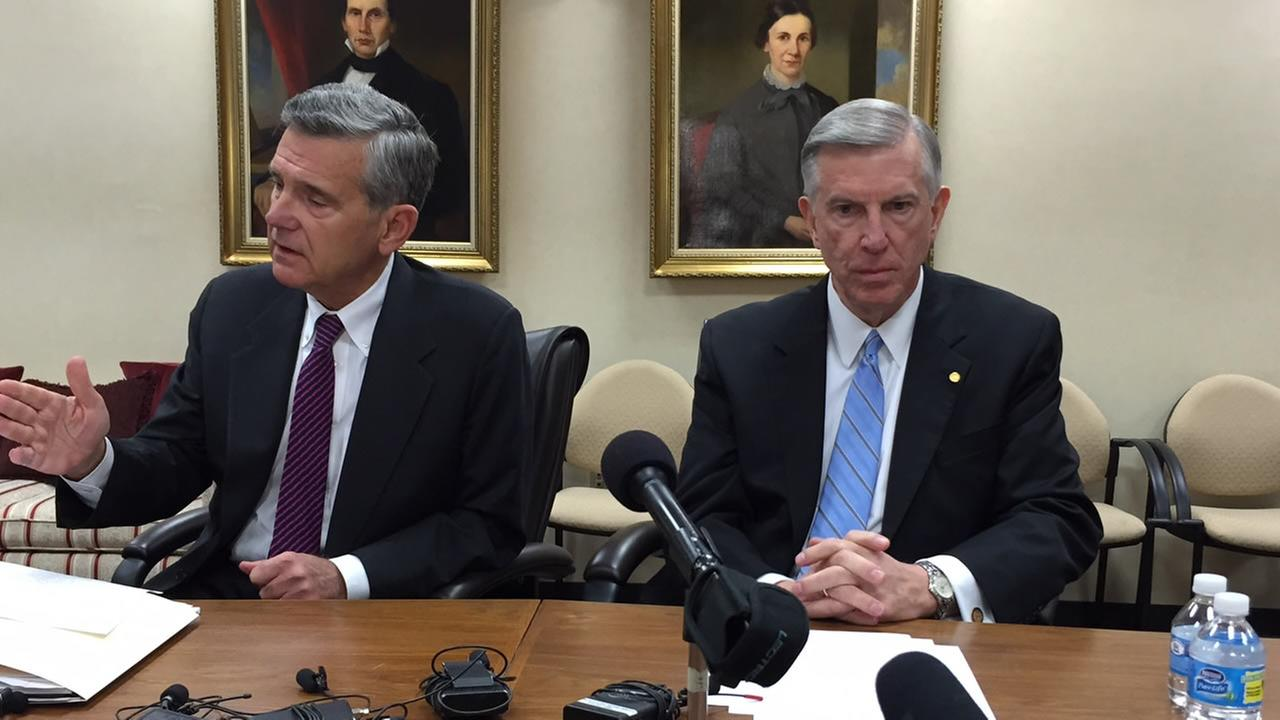 Board of Governors Chairman John C. Fennebresque and UNC President Tom Ross speak with the media Friday.