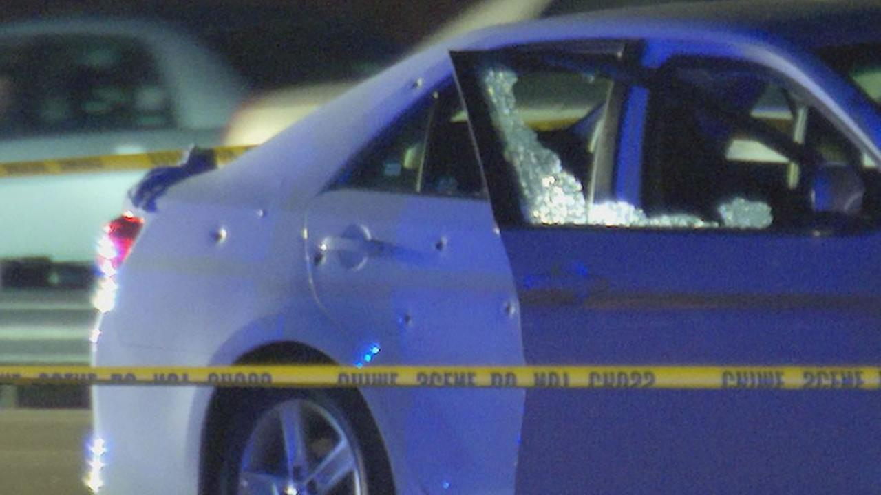 Bullet holes in the side of a car on I-40 eastbound