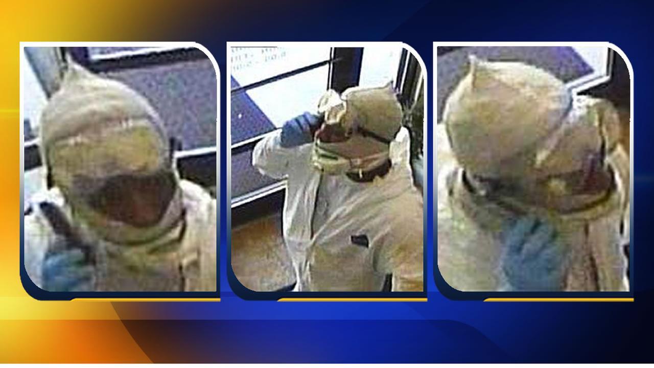 Robbery suspect wears hazmat suit