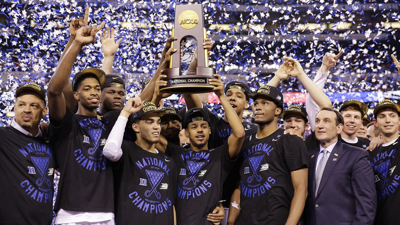 Duke players celebrate with the trophy after their 68-63 victory over Wisconsin in the NCAA Final Four college basketball tournament championship game Monday, April 6, 2015.