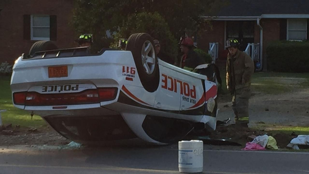 Four Oaks cruiser flips on its roof after a police chase
