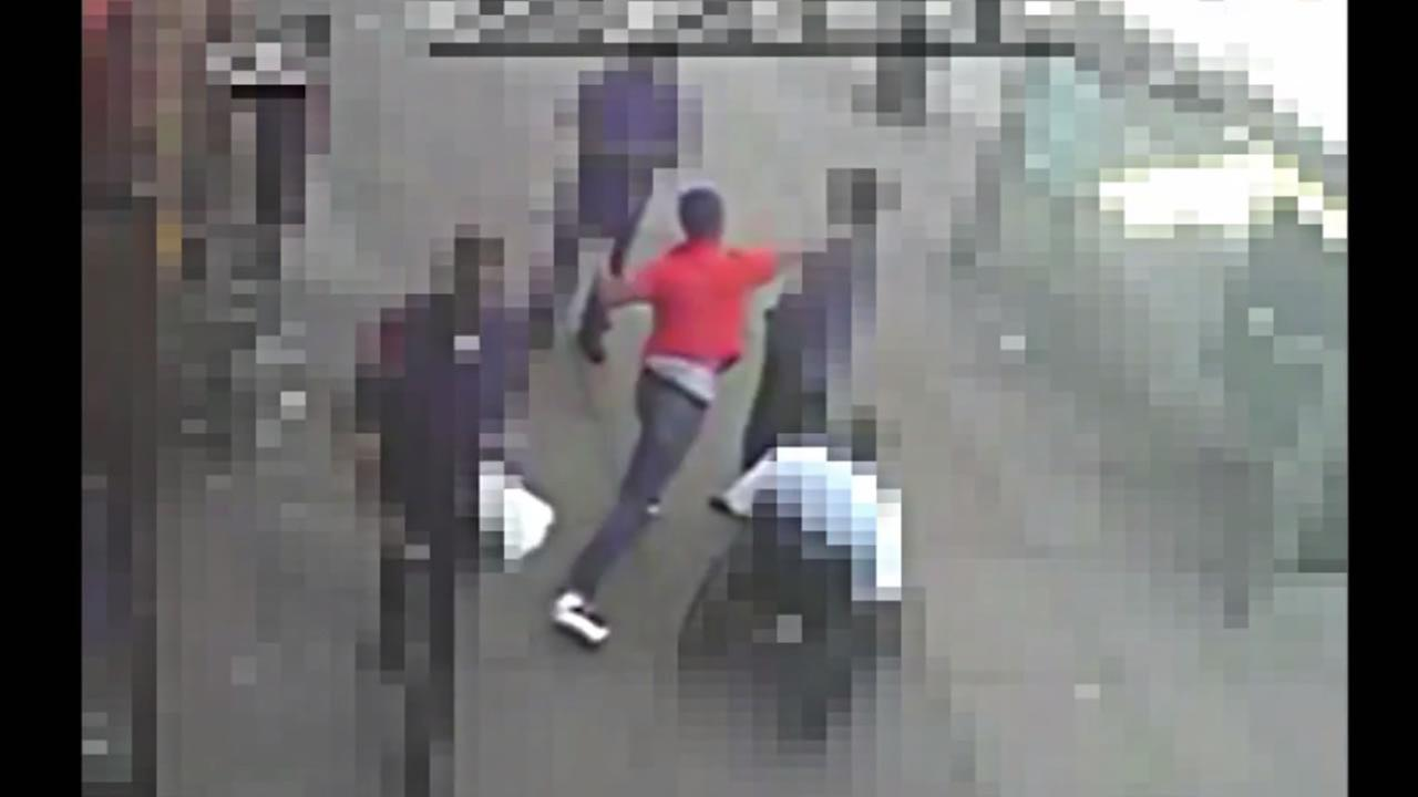 Surveillance video shows the suspect punching the man.