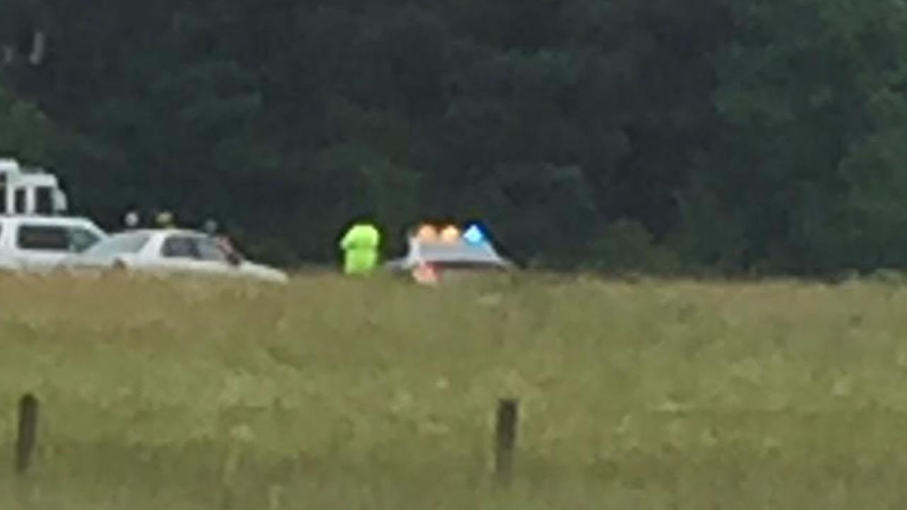 Emergency workers at the scene of a plane crash near Siler City.