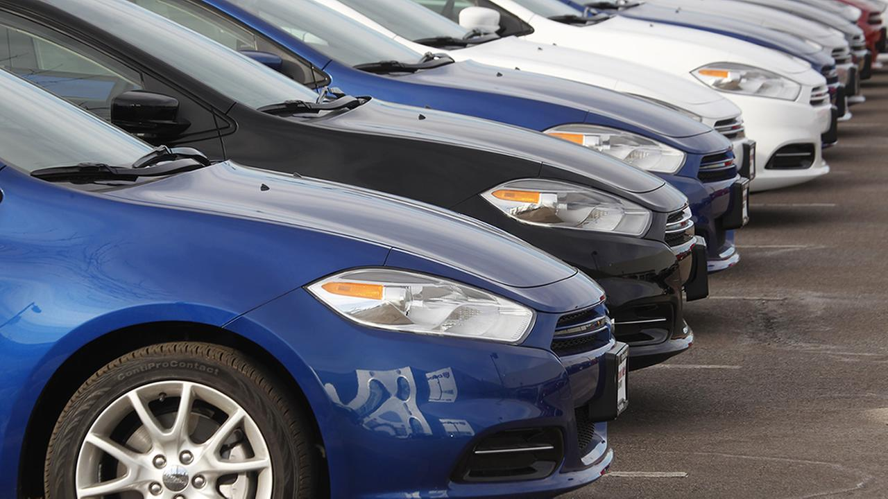In this file photograph taken on Sunday, Jan. 20, 2013, a line of unsold 2013 Darts sits at a Dodge dealership in Littleton, Colo.