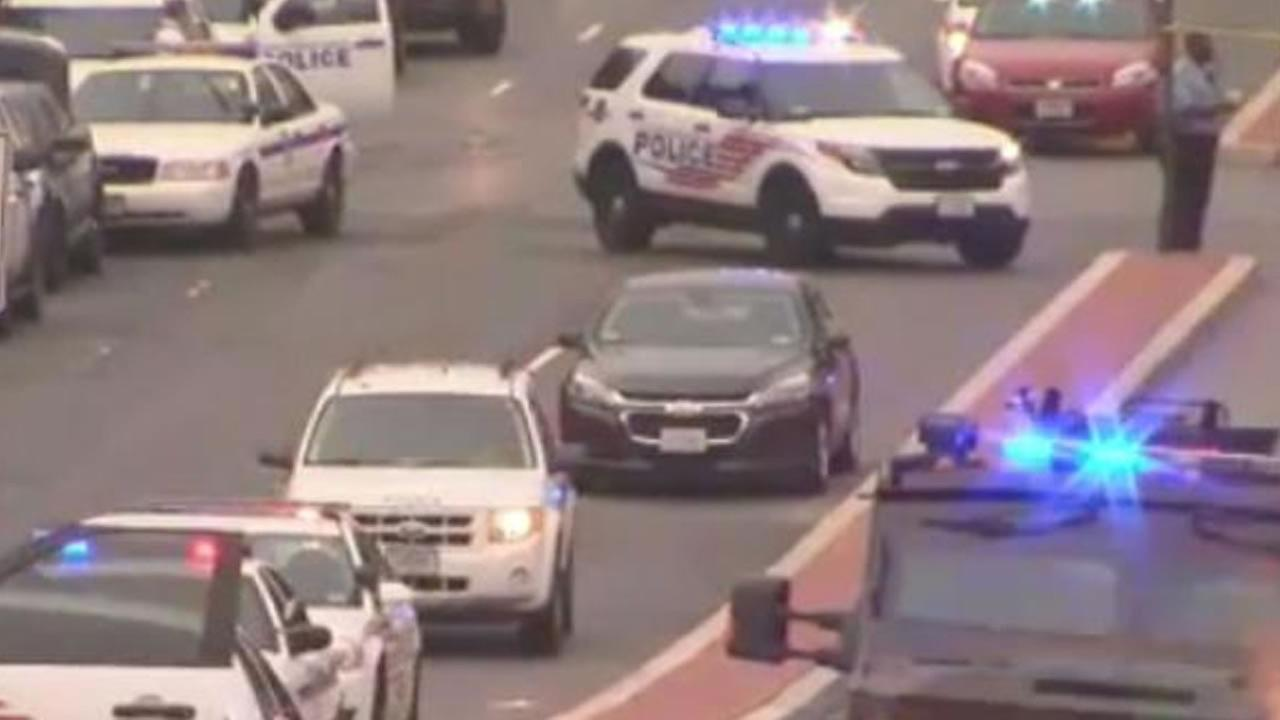 Police respond to a report of an active shooter at the Navy Yard in Washington, DC (image courtesy WJLA-TV)
