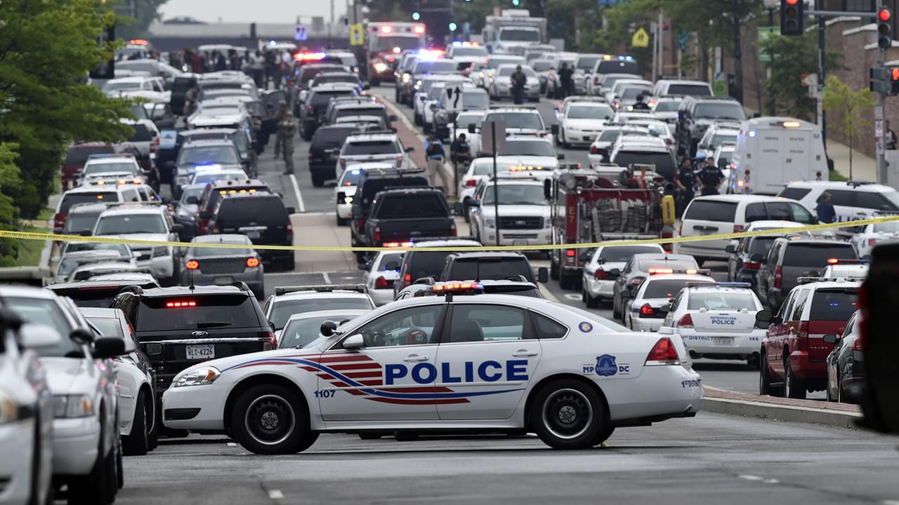 Police vehicles are seen near the Washington Navy Yard.