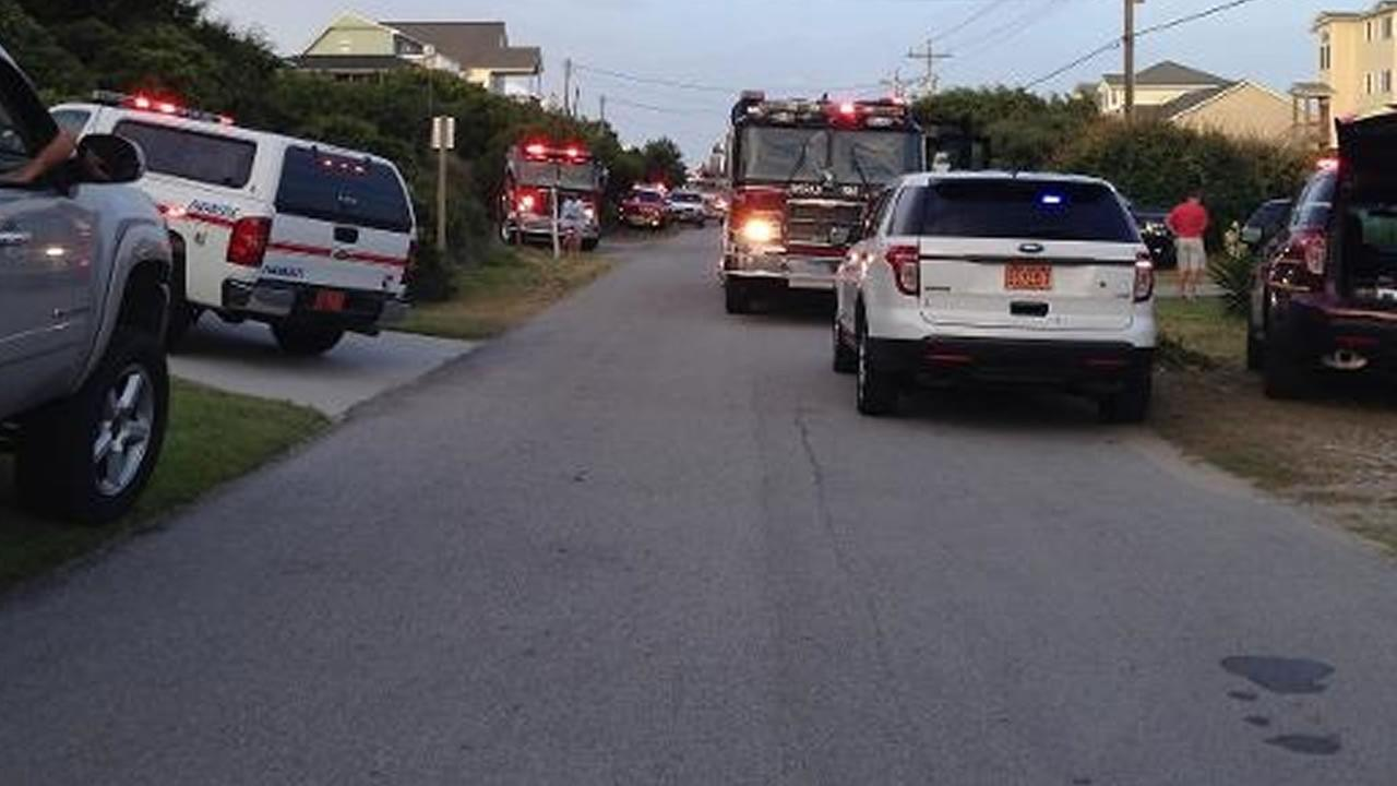 Emergency vehicles at the scene of a deck collapse on Emerald Isle (image courtesy WCTI-TV)