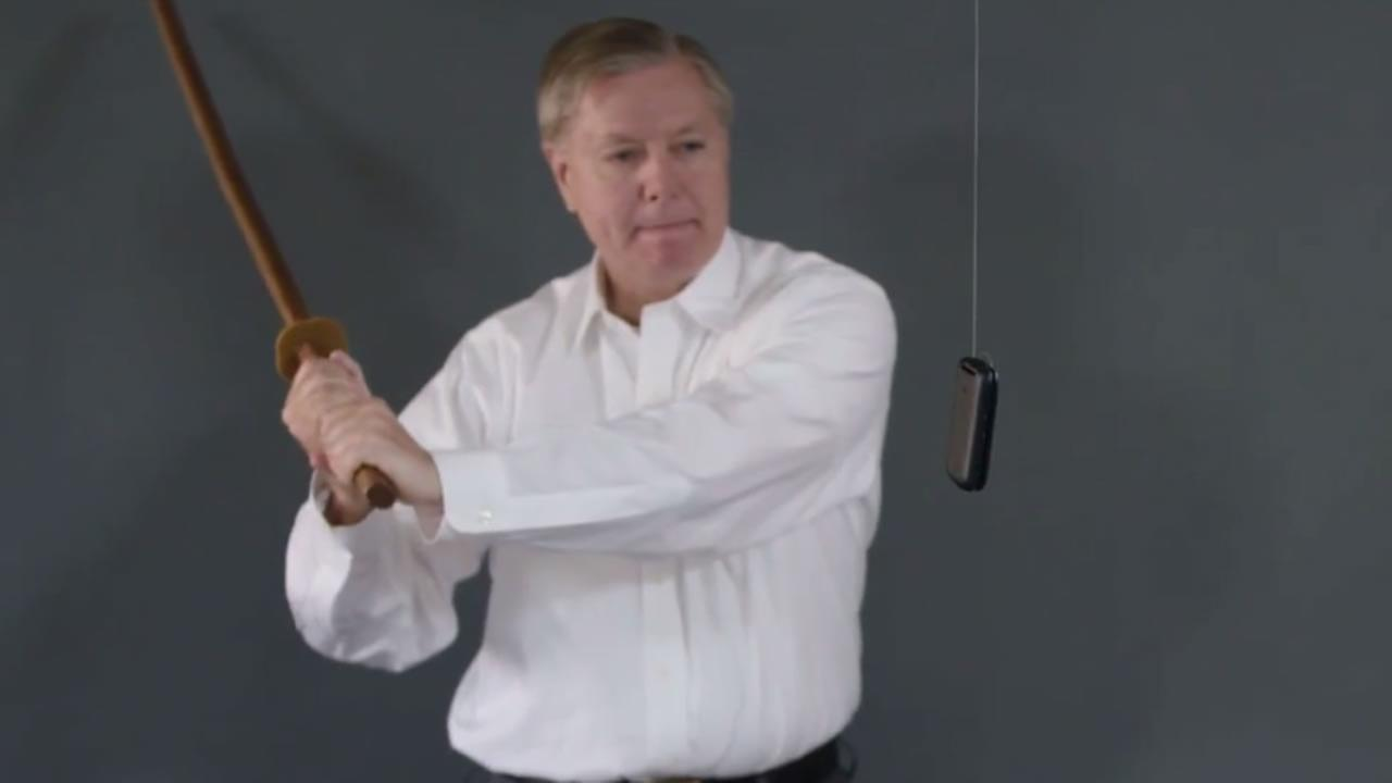South Carolina Senator Lindsey Graham takes a sword to his cell phone.