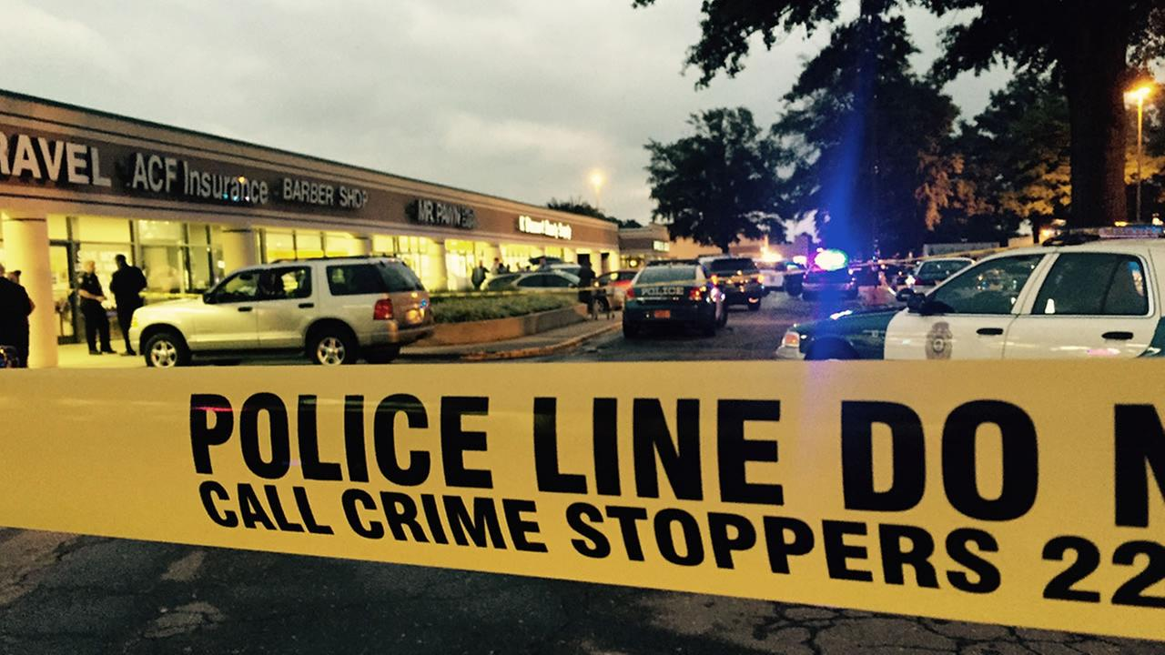 Police investigate a shooting at Mr. Pawn on Capital Boulevard.