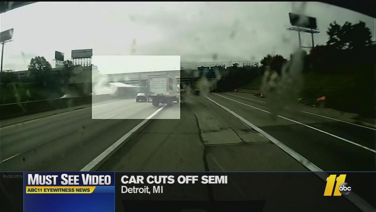 Must-see video: Car cuts off semi, causing it to crash into bridge