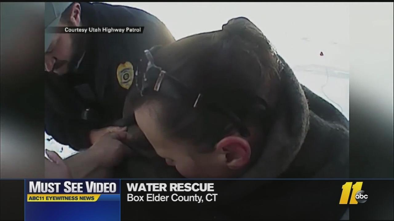 Must-see video: Woman, dogs rescued from icy water