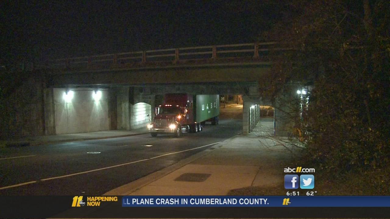 Another truck wedged under Durham bridge