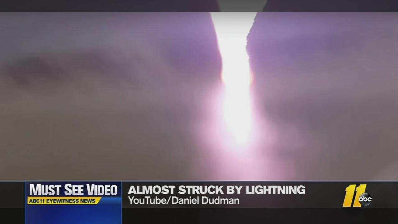 Men nearly struck by lightning