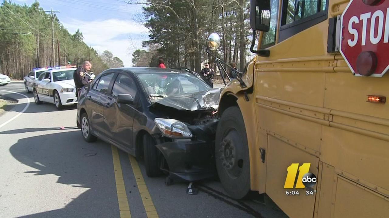 Car slams into Durham school bus