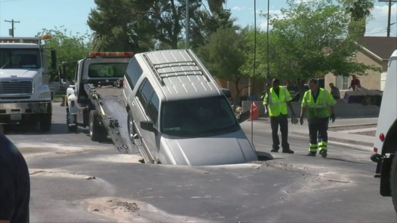 SUV falls in sinkhole