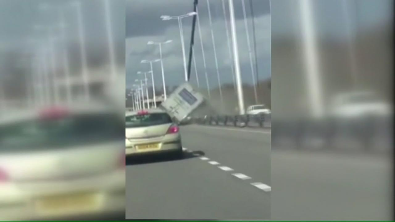 Wind knocks over truck on bridge