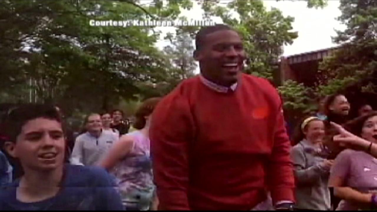 Cam Newton plays football with seventh-graders