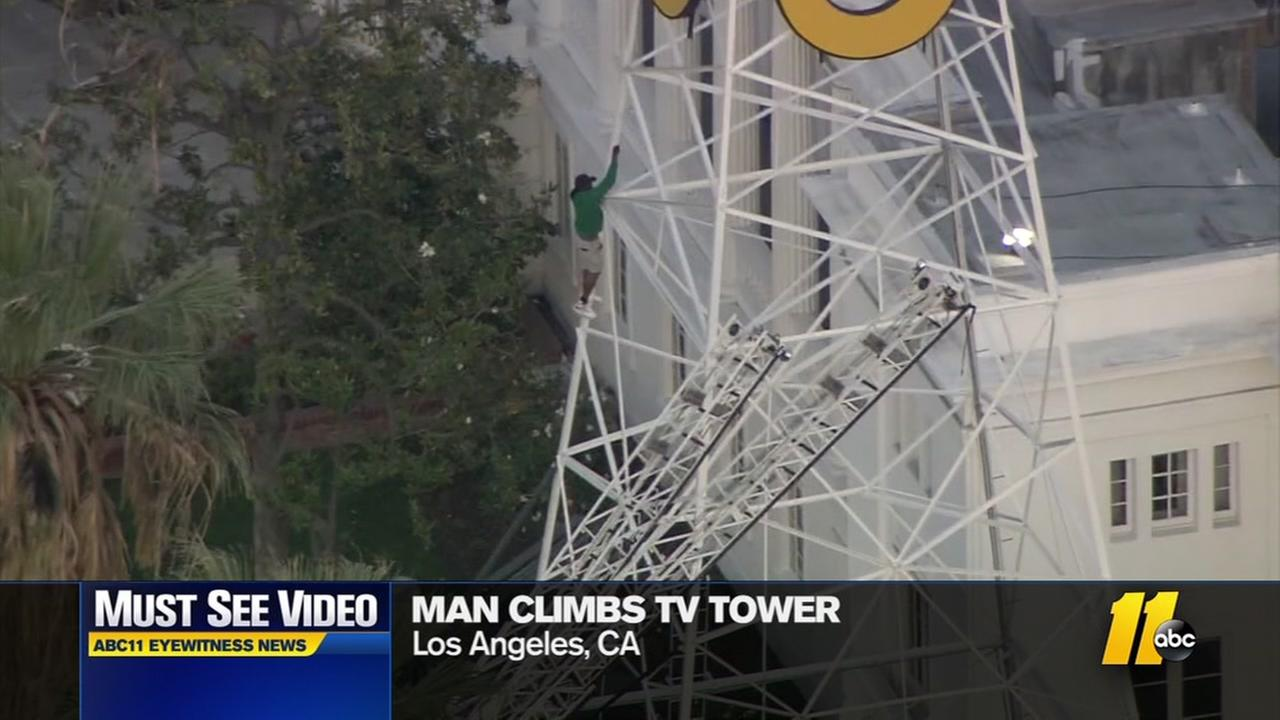 Man climbs TV tower