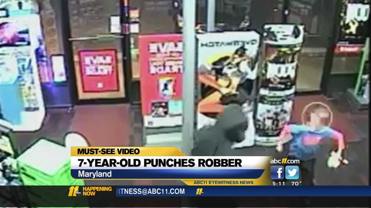 7-year-old punches robber