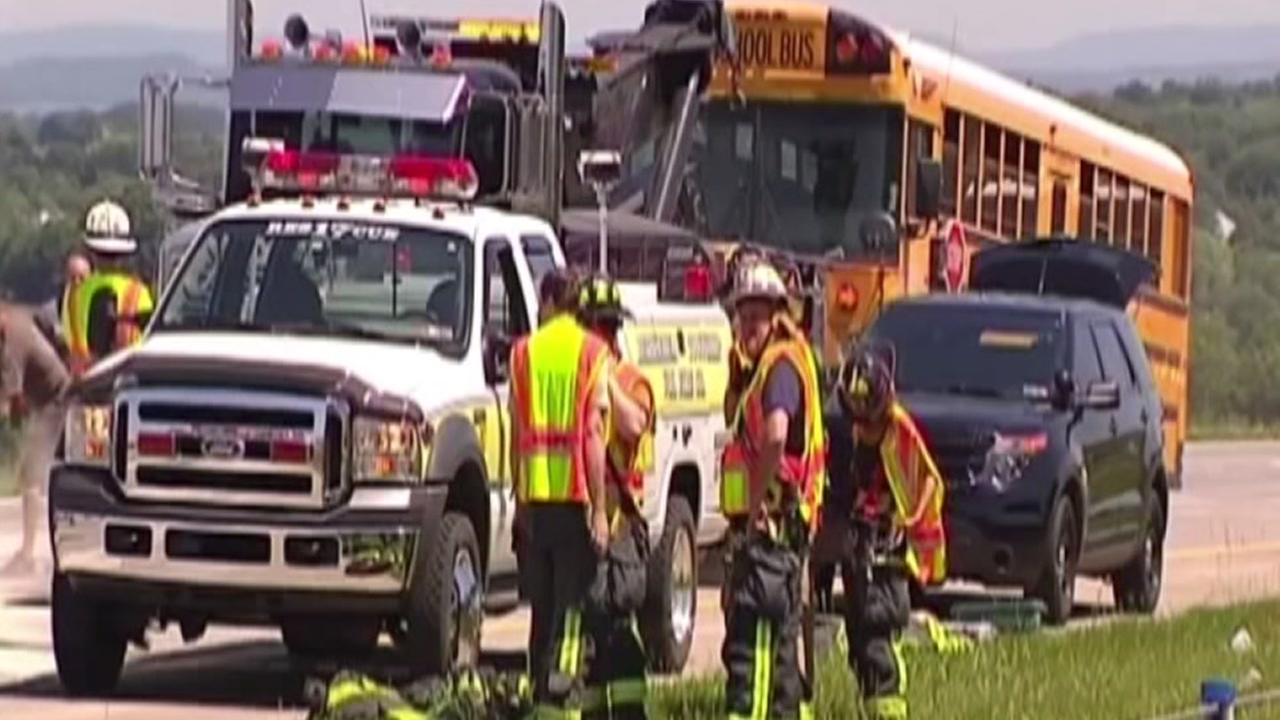 Must-see video: School bus hit by semi-truck