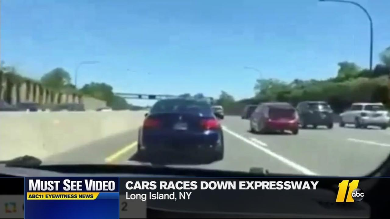 Cars race down expressway