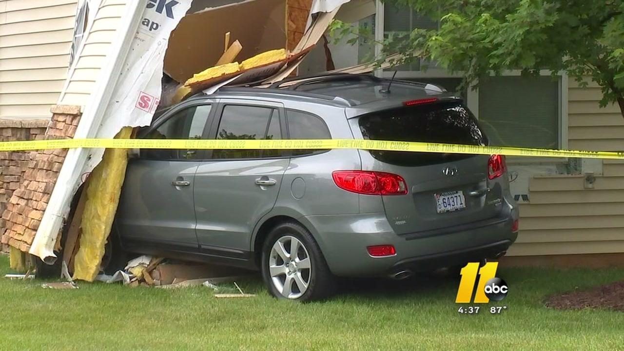Elderly woman hits house on test drive