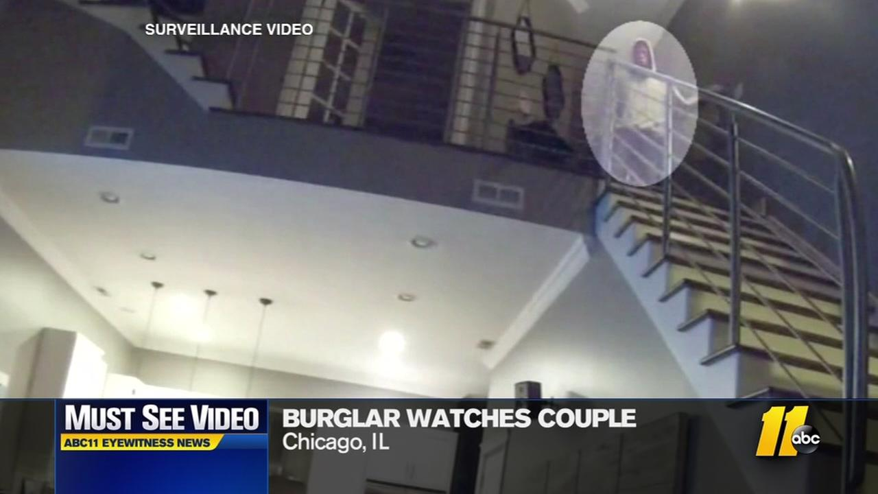 Burglar watches sleeping couple