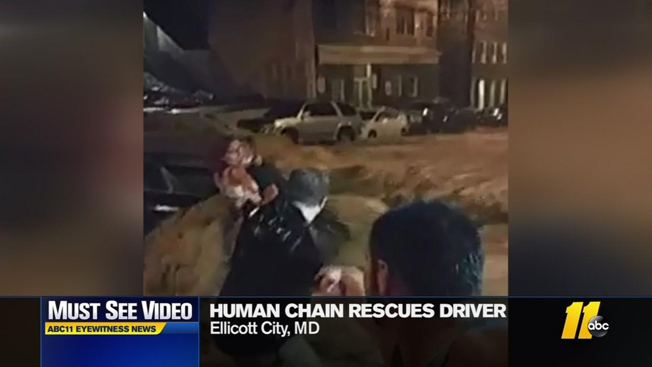 Men create hunman chain to rescue driver