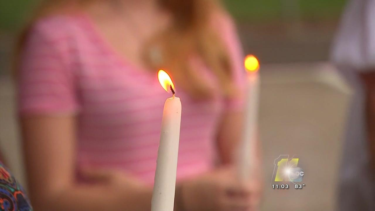 A vigil is held to remember a young shooting victim