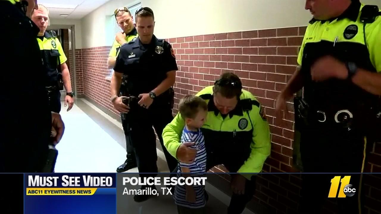 Officers escort fallen policemans son to school