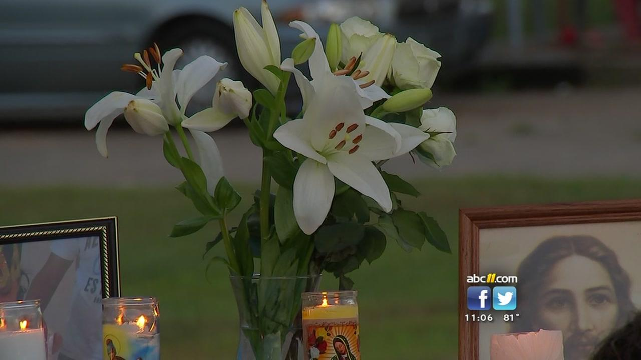A Durham neighborhood lit candles and laid flowers to mourn a little girl