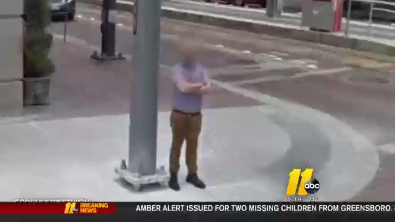 man with wet spot on pants captured on google street view