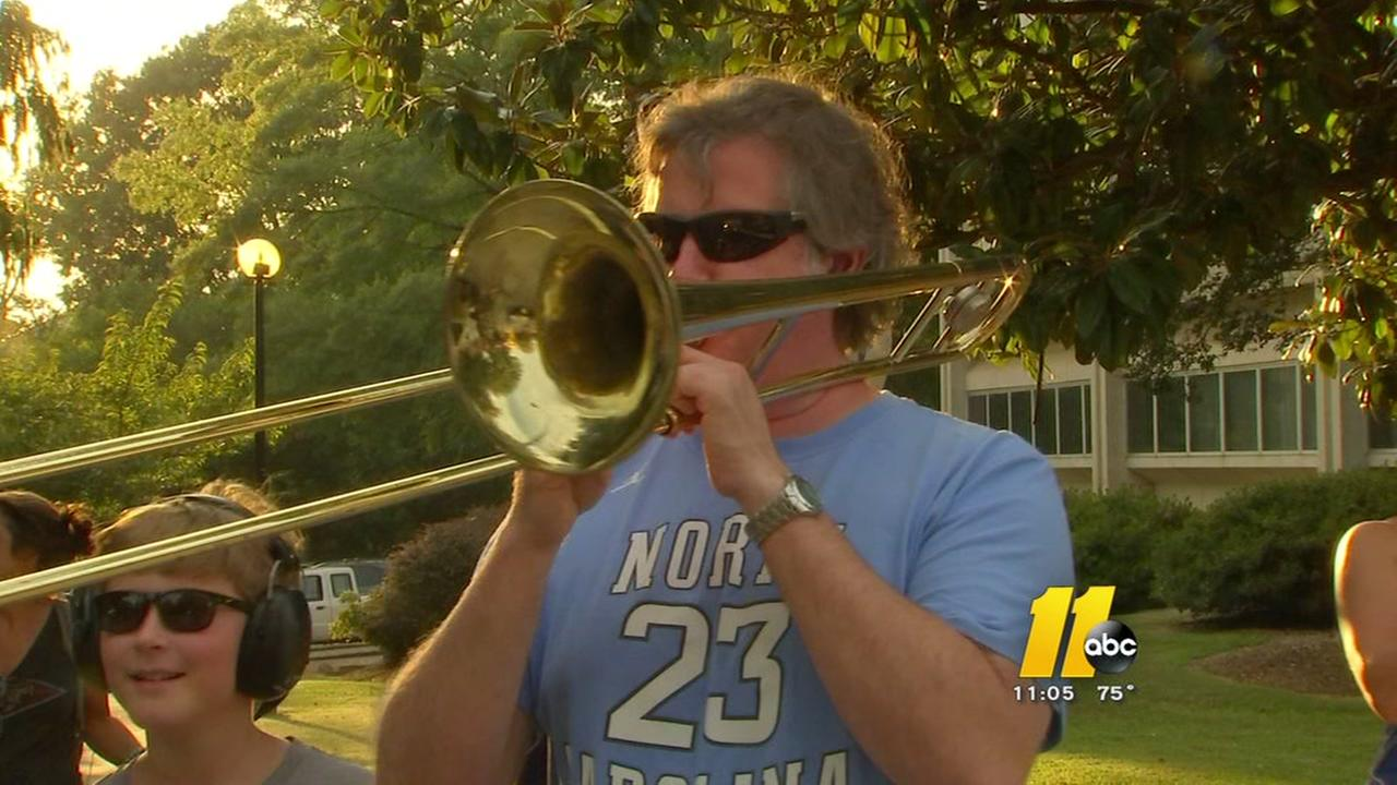 Air horn orchestra takes on a sports theme in latest protest