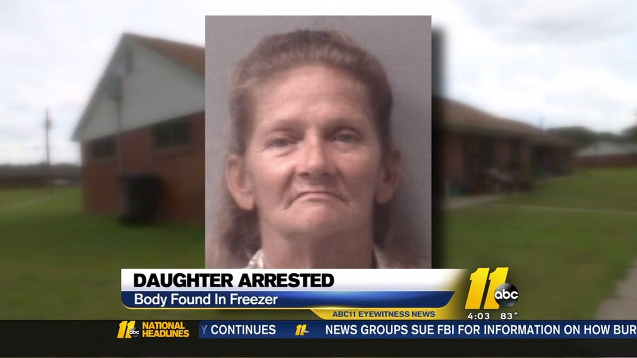 Police arrest daughter of woman found in freezer