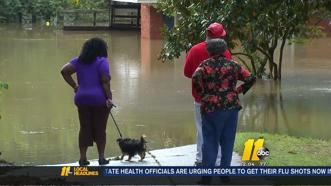 Residents try to deal with flooded homes