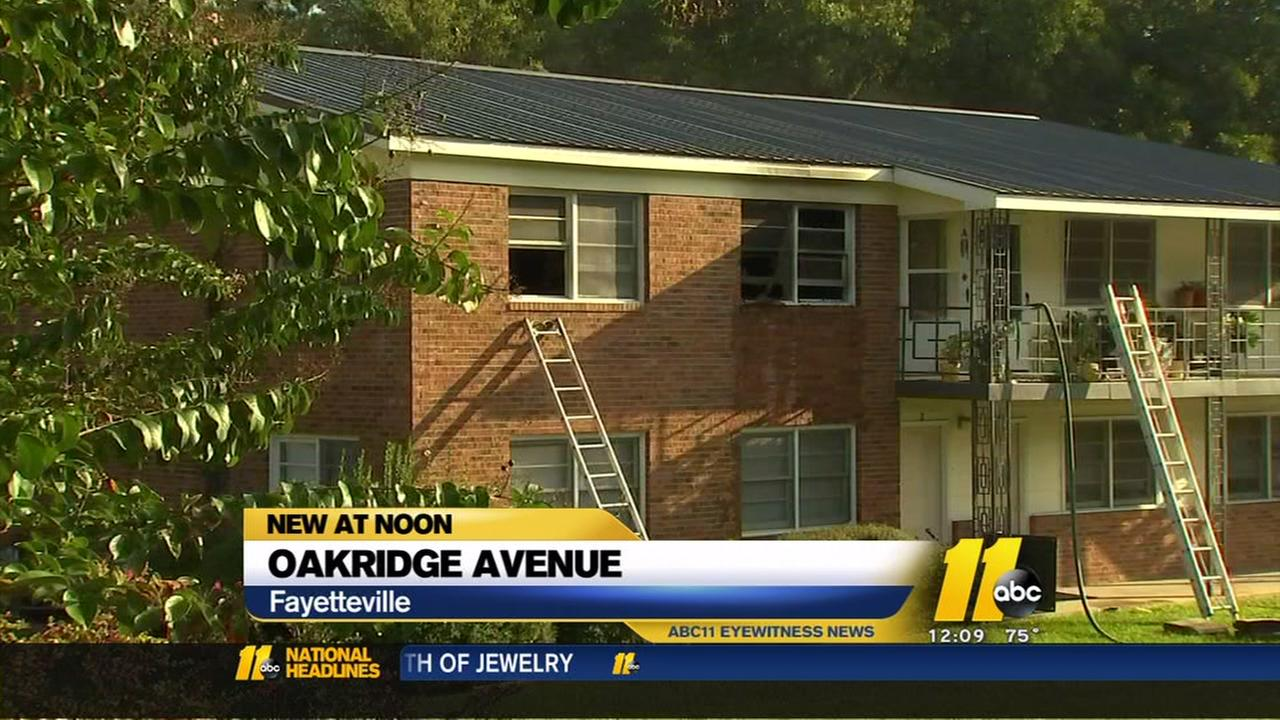 Woman, dog rescued from burning Fayetteville apartment