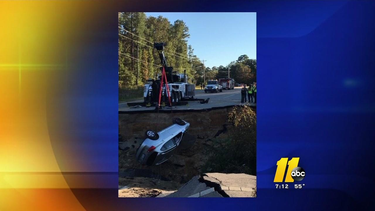 Driver crashed into washed out road