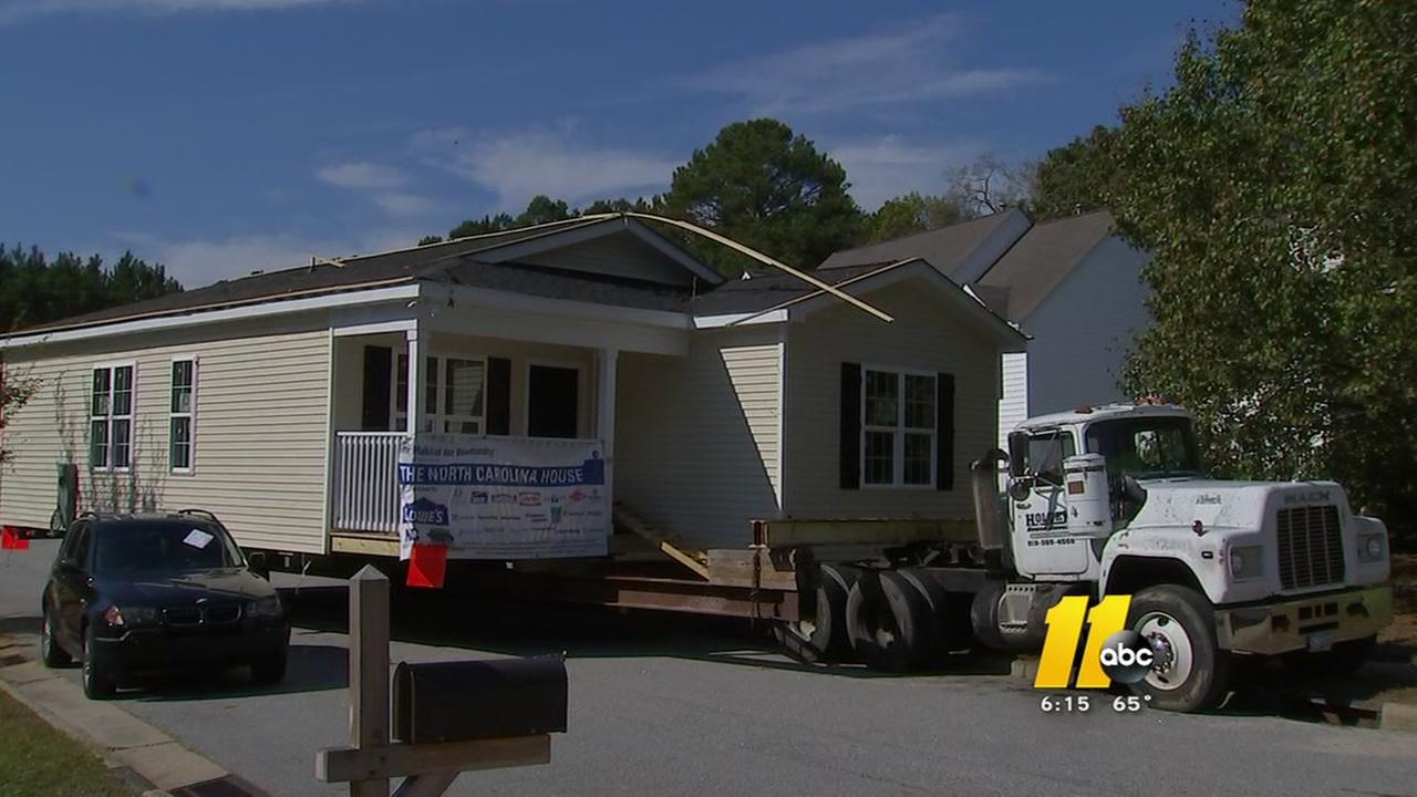 Habitat Wake builds, moves house for family in need